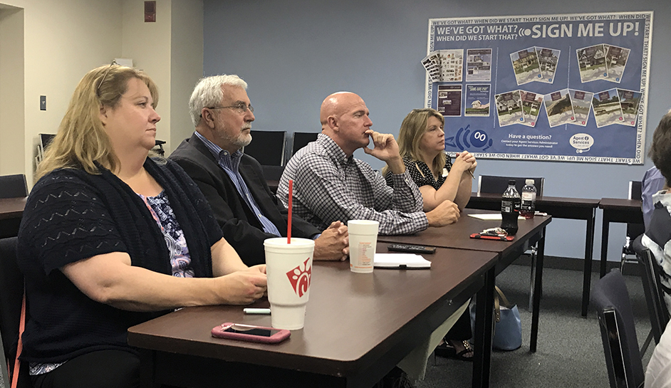 L-R: Aimee Johnson (Waldorf branch managers), Bill Frost (director of education), Jay Wise (Ocean City manager) and Marie Lagos (Frederick and Rockville manager) listen to Chuck Kasky's presentation.